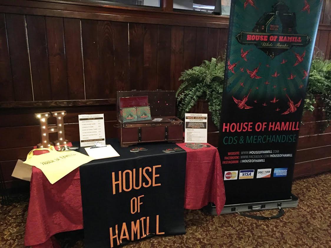 House of Hamill merch table - Bandzoogle Blog